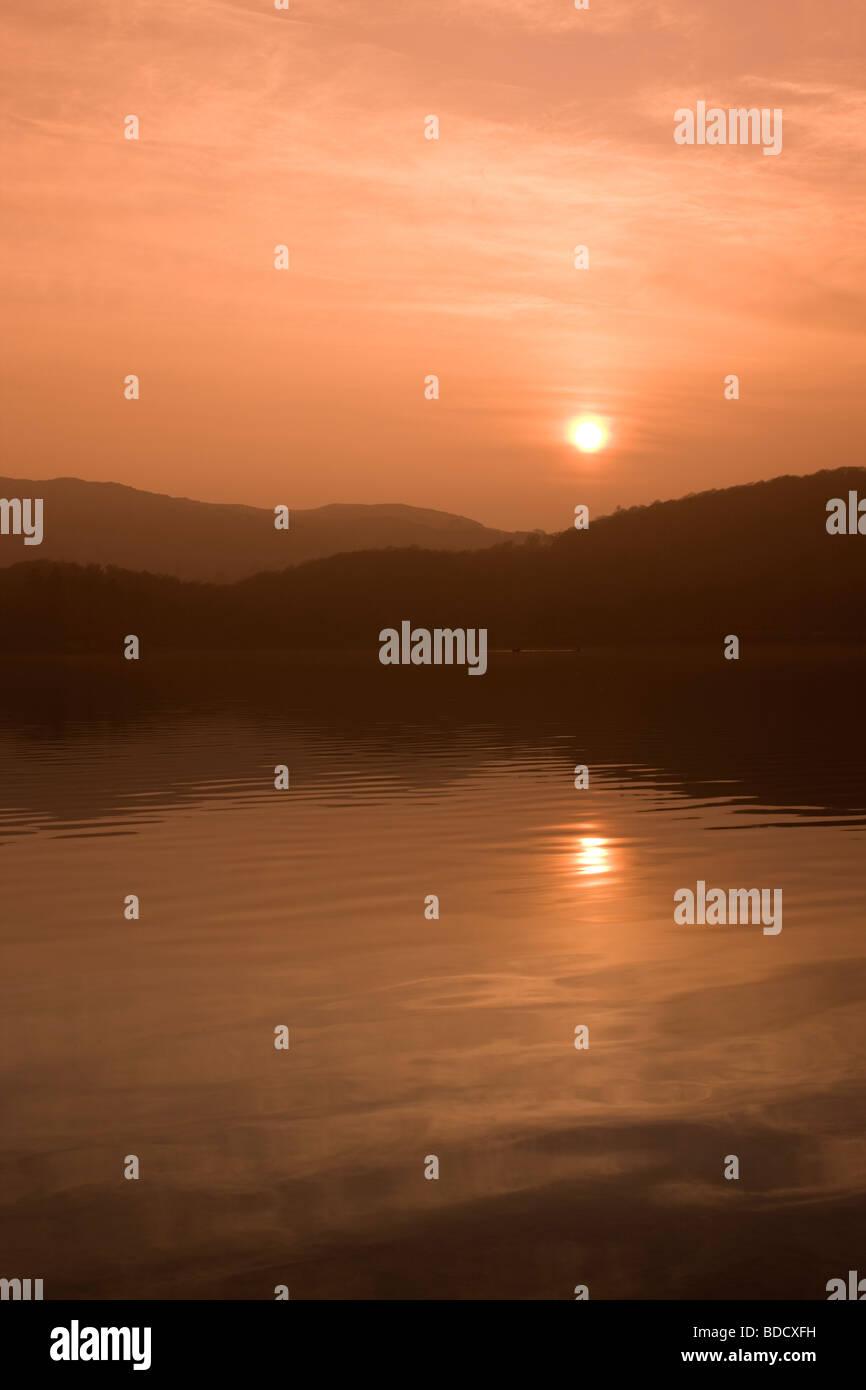 Sunshine Reflecting on Lake, Lancashire, UK - Stock Image