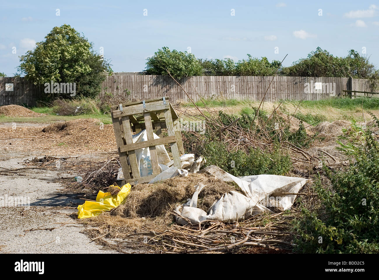 Rubbish dumped on open land - fly tip tipping - Stock Image