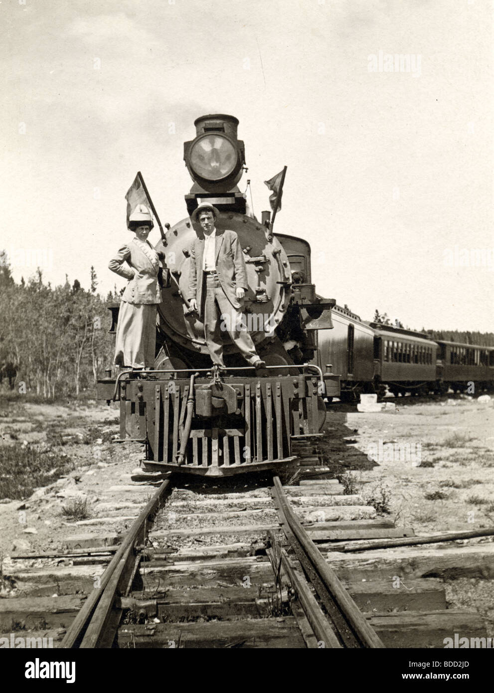 Couple Standing on Front of Locomotive Stock Photo