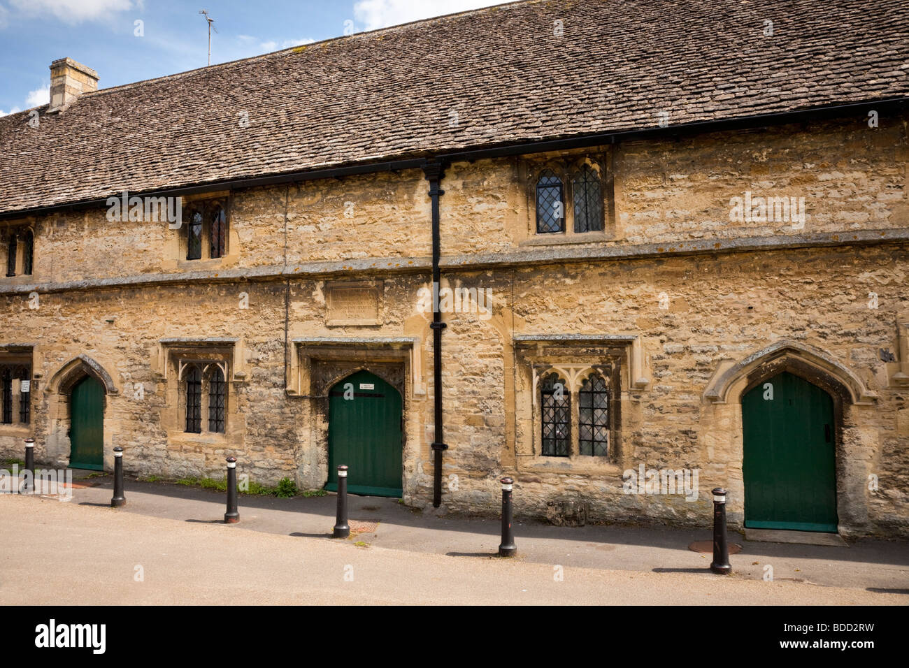 15th Century Almshouses in the Cotswolds town of Burford, Oxfordshire, England, UK - Stock Image
