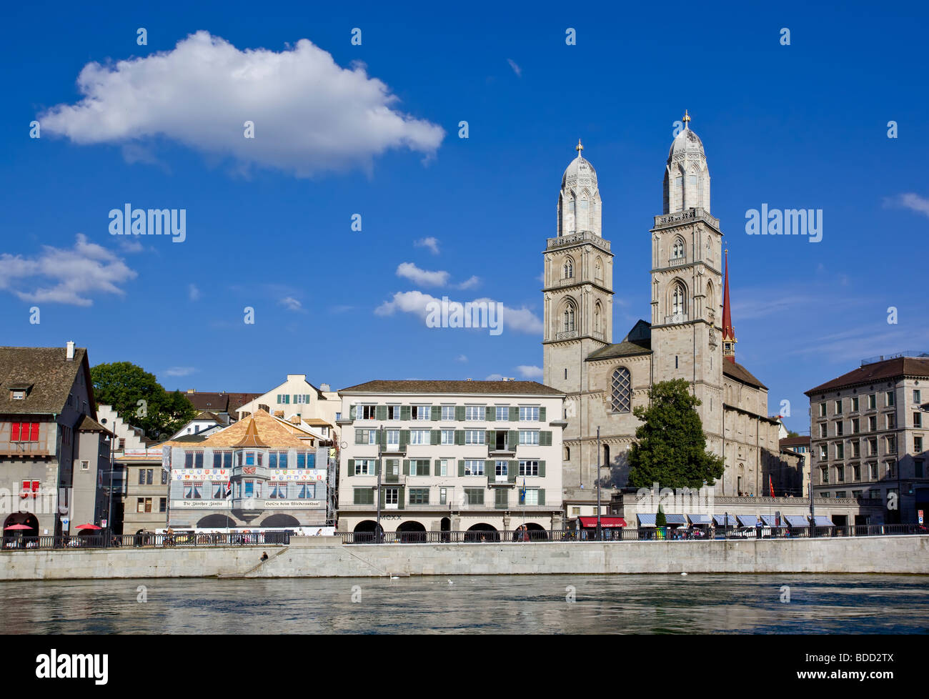 Zurich Fraumünster cathedral on the banks of the river Limmat - Stock Image