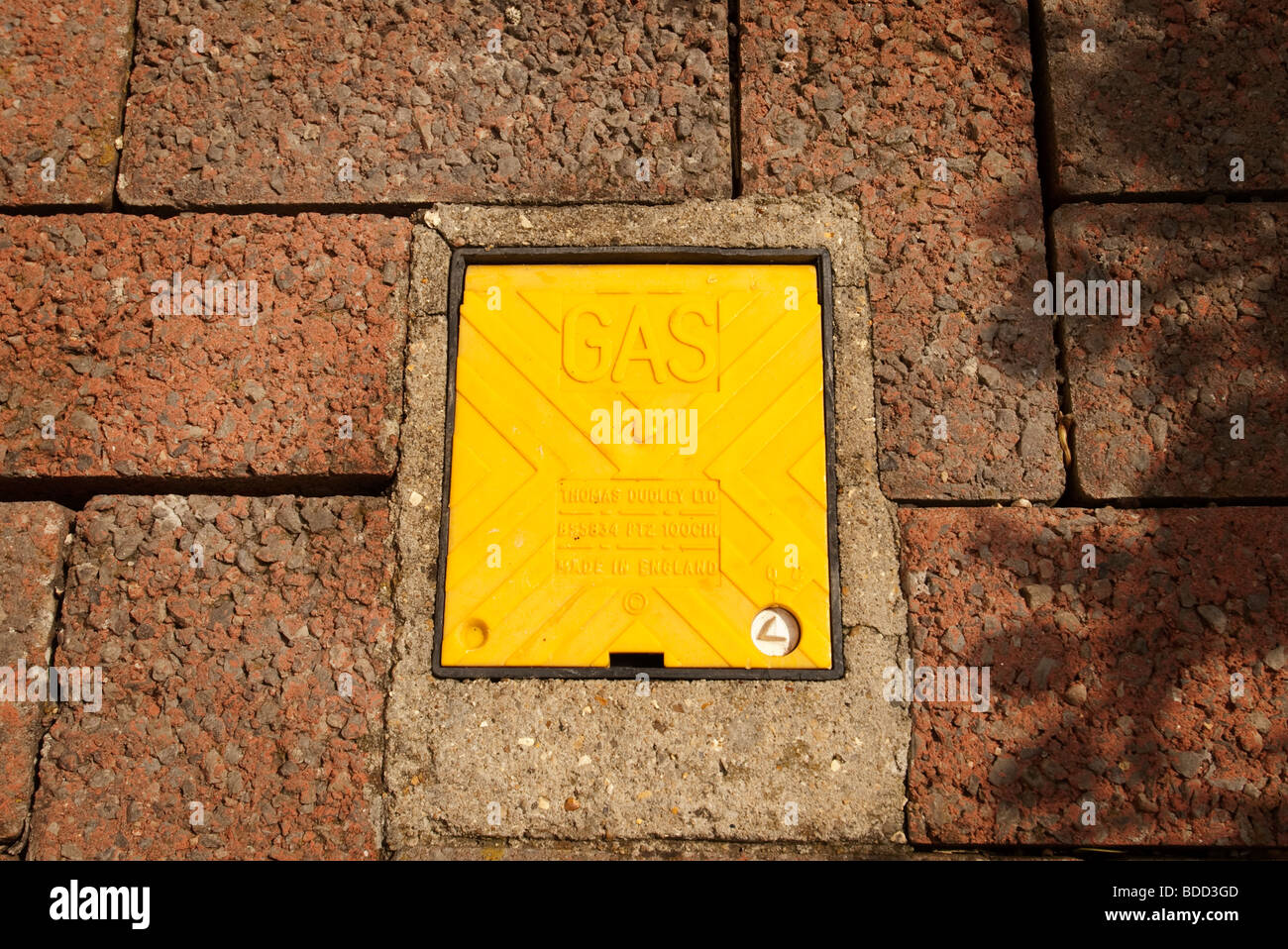 yellow gas mains cover - Stock Image