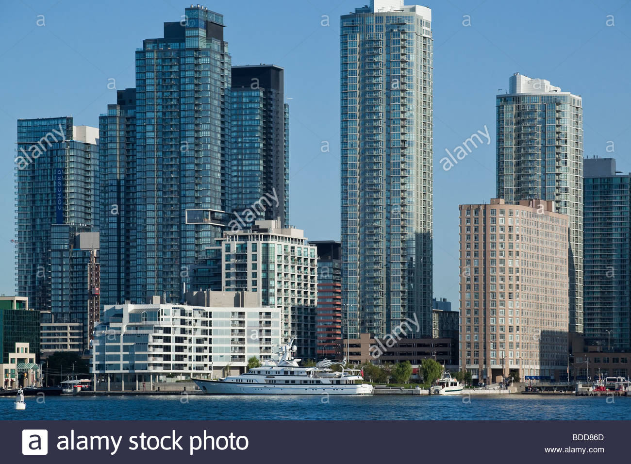 Condos and private yacht at Harbourfront in Toronto Ontario Canada - Stock Image