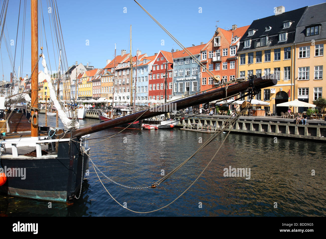 The canal in Nyhavn, Copenhagen - the old harbour quarter famous for  the old painted houses, restaurants, bars, - Stock Image