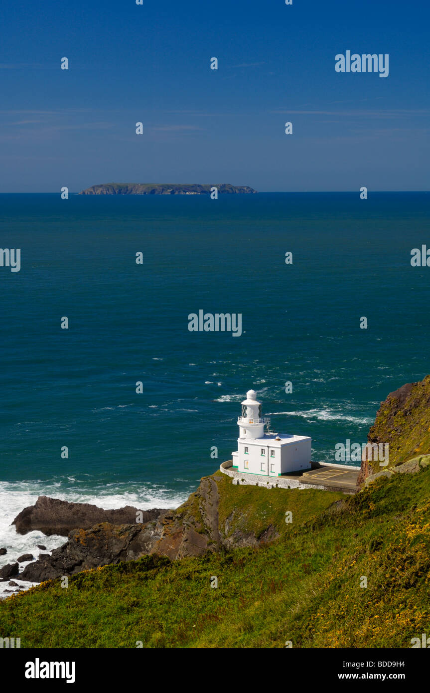 Hartland Point lighthouse on the North Devon Coast with Lundy Island on the horizon, England, United Kingdom. - Stock Image