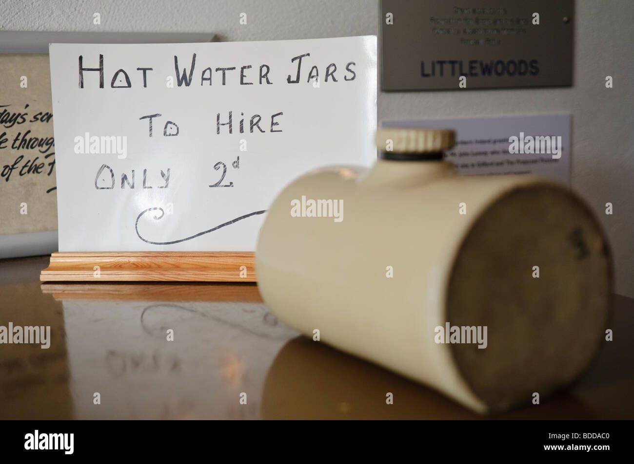 Old fashioned sign: Hot Water Jars to hire only 2d - Stock Image