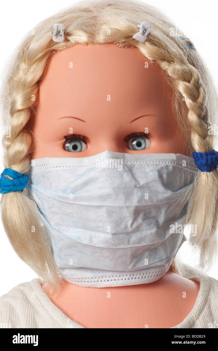 A doll with a mouth mask to prevent influenza - Stock Image