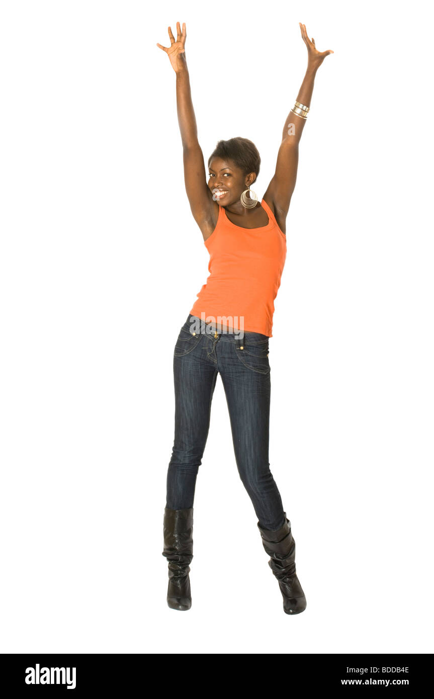 Studio portrait of a happy attractive young African woman with arms in the air posing against a pure white (255) - Stock Image