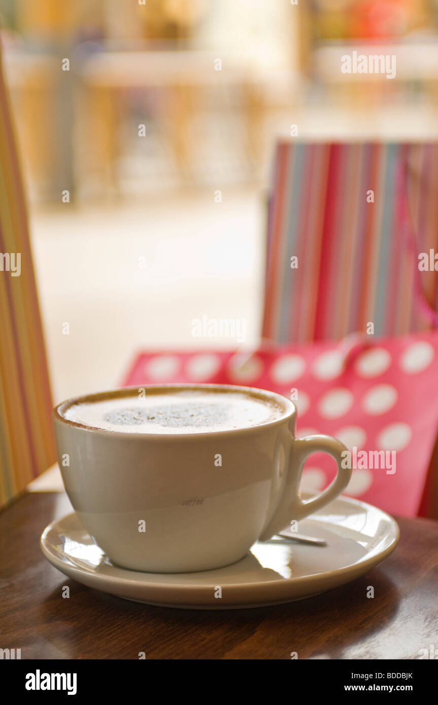 Concept coffee, shopping, bags, break at a shopping center. - Stock Image