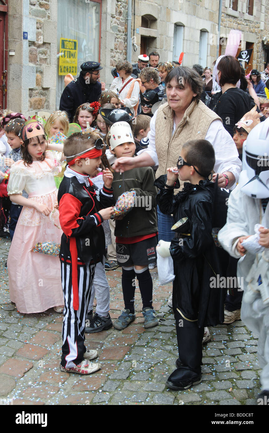 A parade of school children in Paimpol in Brittany - Stock Image
