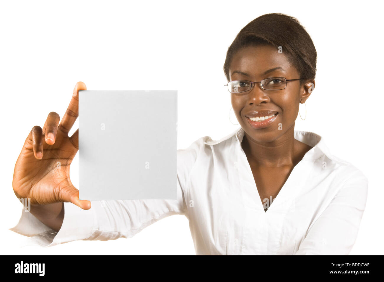 A happy attractive African business woman holding up a blank card for text or graphics against a pure white (255) - Stock Image