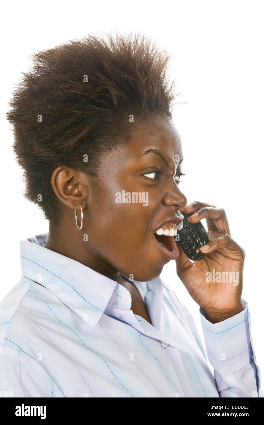 Studio portrait of an attractive angry shouting African business woman on a mobile phone against a pure white (255) - Stock Image
