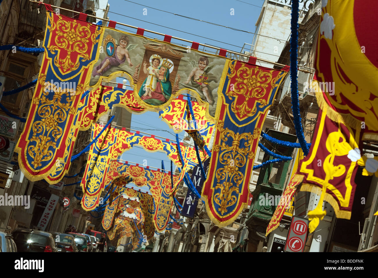 Colourful religious banners in the street, Sliema, Malta - Stock Image