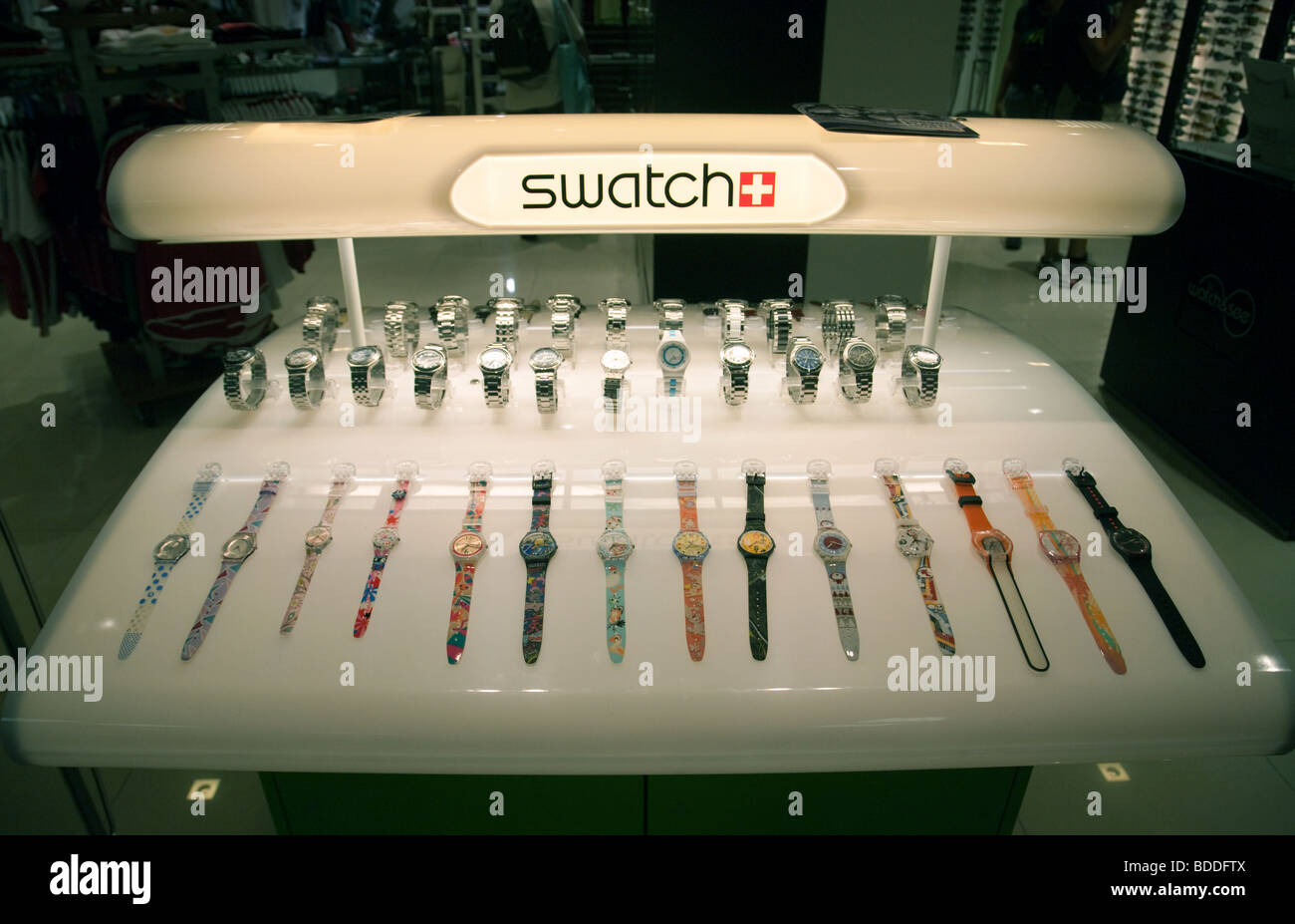 A display case of Swatch watches for sale - Stock Image