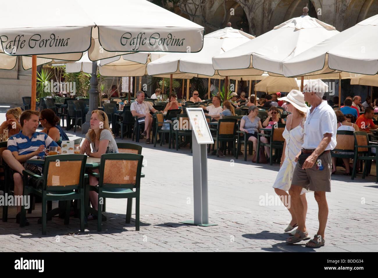 Tourists stop to look at the menu, Caffe Cordina, Republic Square, Valletta, Malta - Stock Image