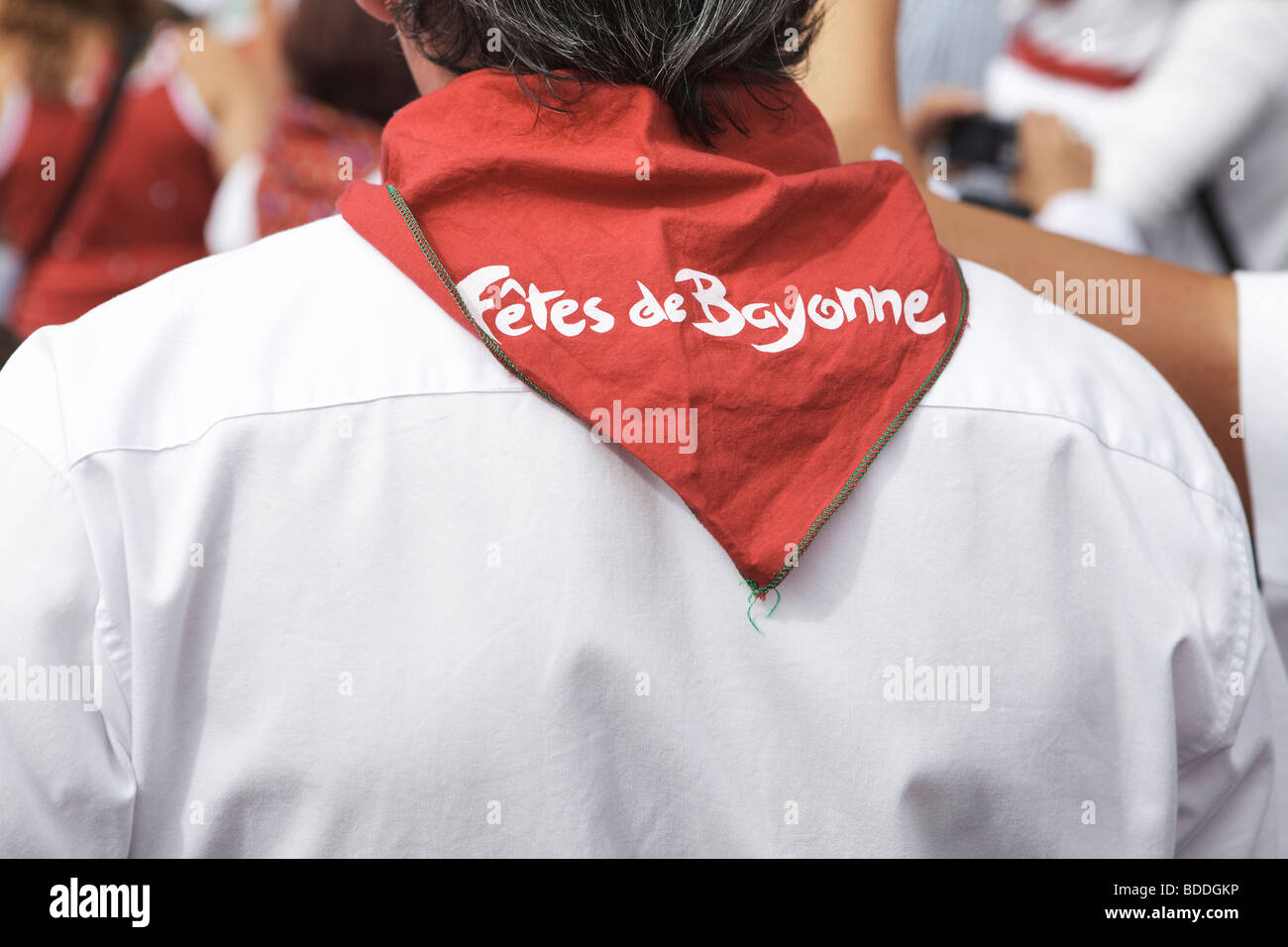 Red neckerchief on festival goer at the Fetes de Bayonne, France - Stock Image