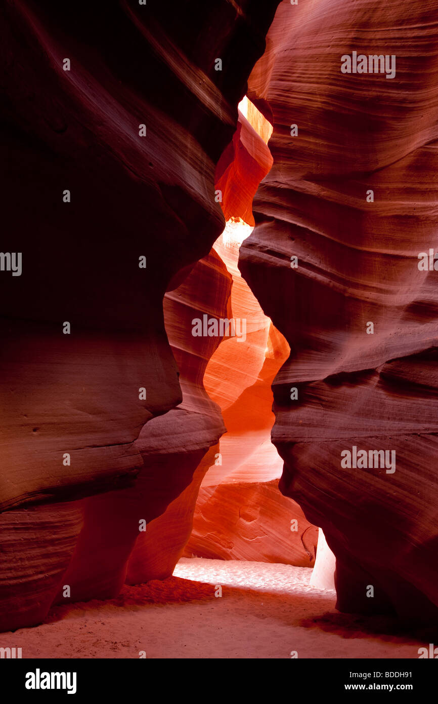 Beautiful spiritual shaft of light in upper Antelope Canyon tourist vacation attraction Southwest US American Indian Stock Photo