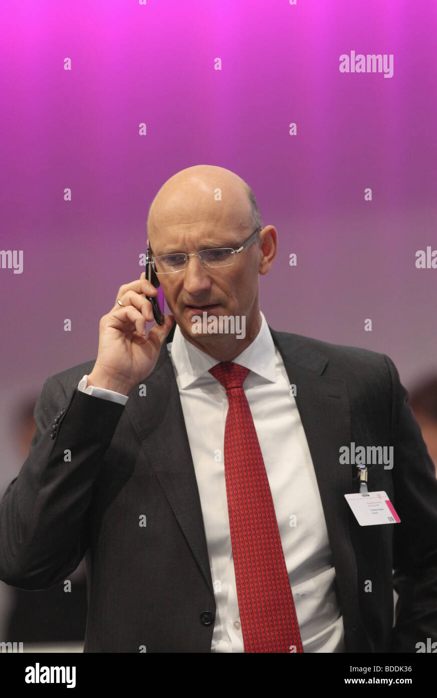 Deutsche Telekom board member Timotheus Hoettges talking on a mobile phone, annual shareholders meeting, Cologne. Stock Photo