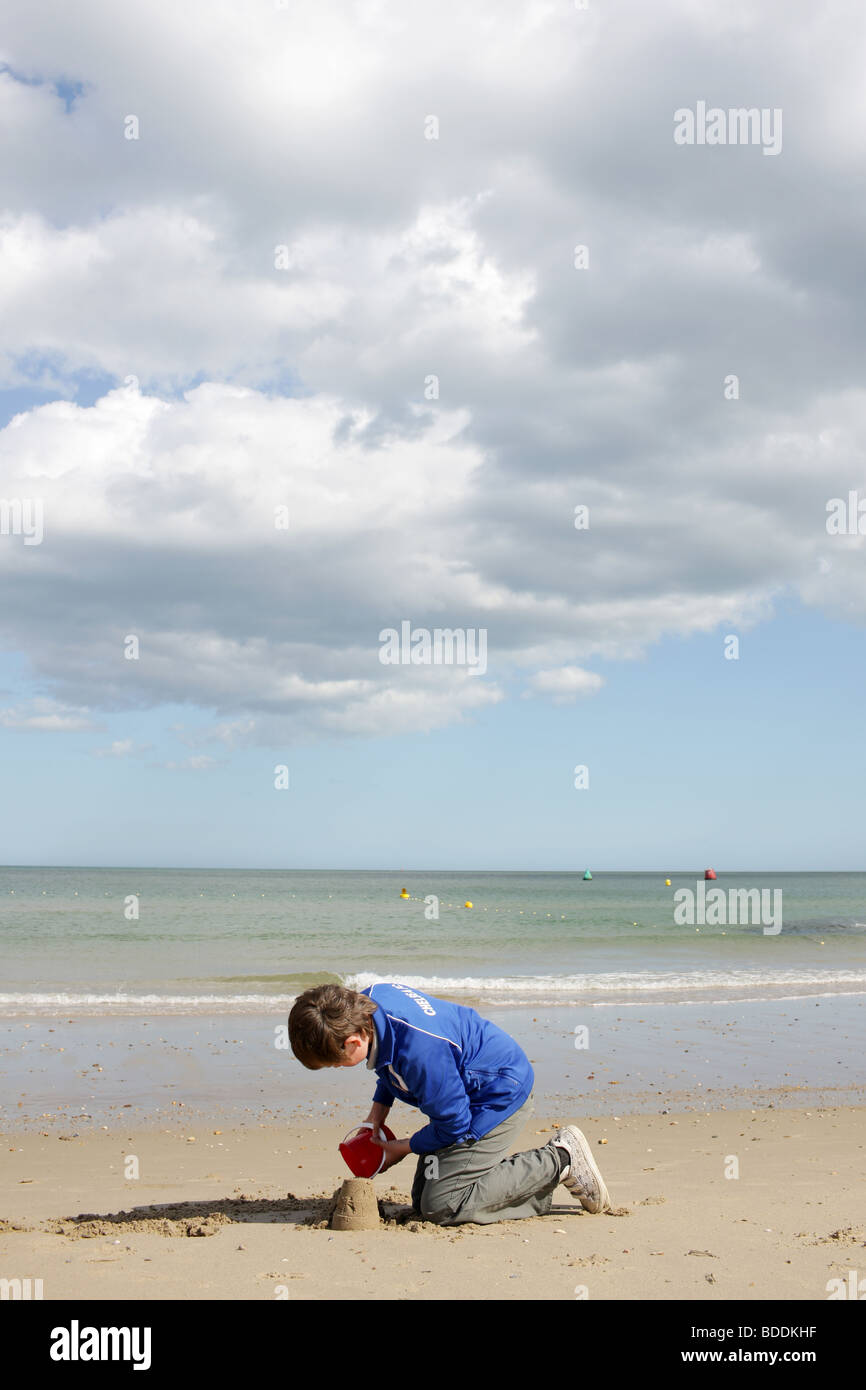 Young Boy Playing at the Beach. Model Released - Stock Image