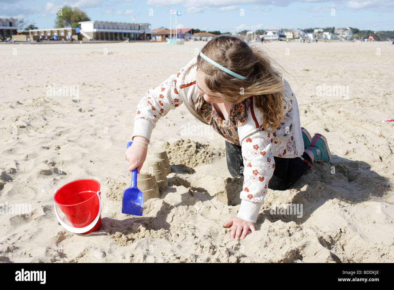 Young Girl Playing at the Beach. Model Released - Stock Image
