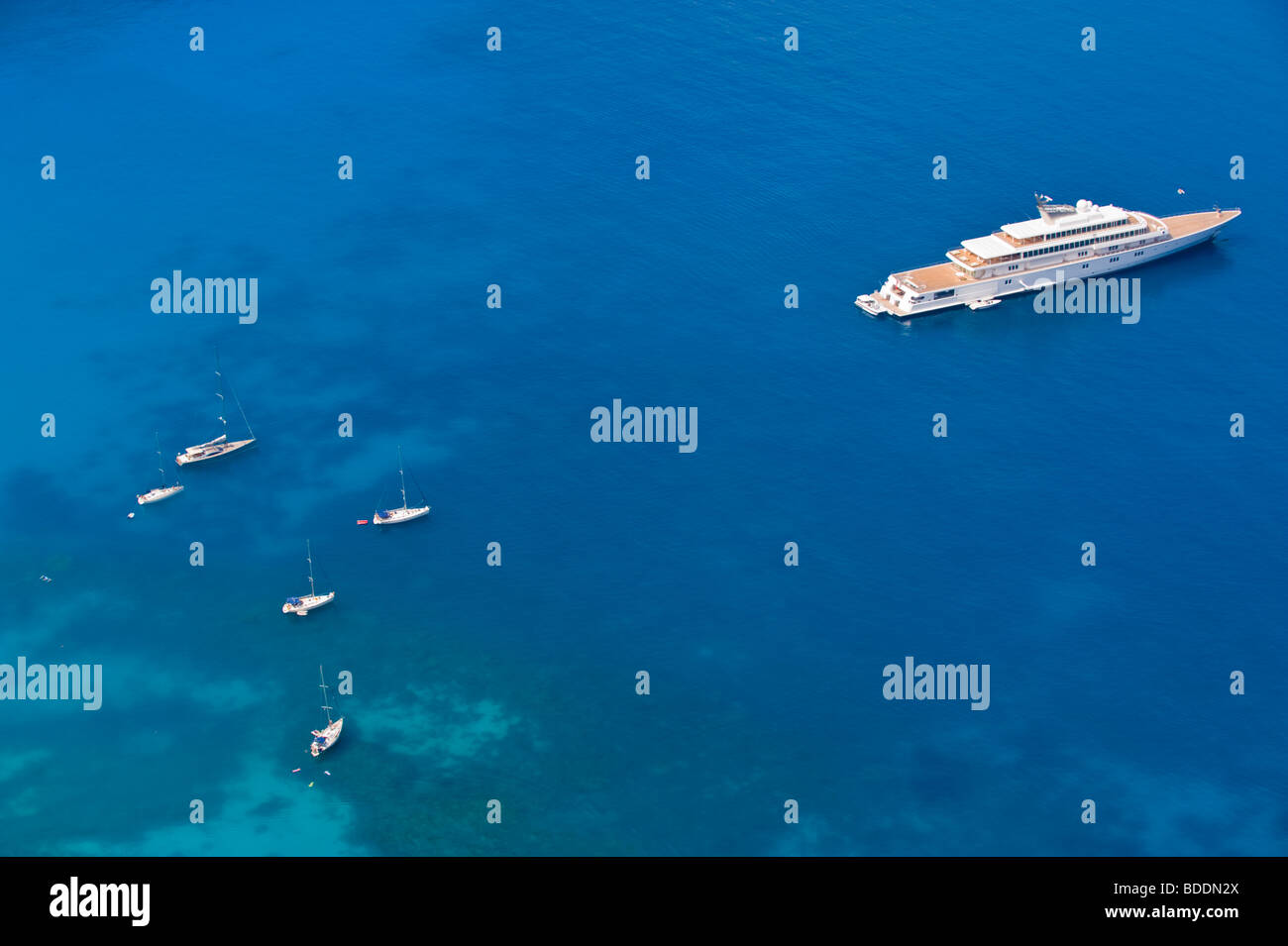 Luxury super yacht RISING SUN owned by Larry Ellison and David Geffen anchored off Myrtos Beach on island of Kefalonia - Stock Image