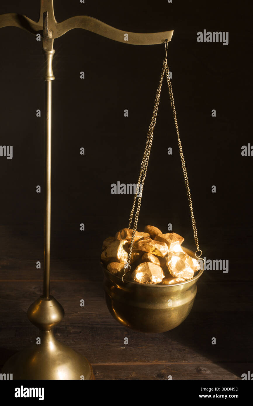 Weighing gold. - Stock Image