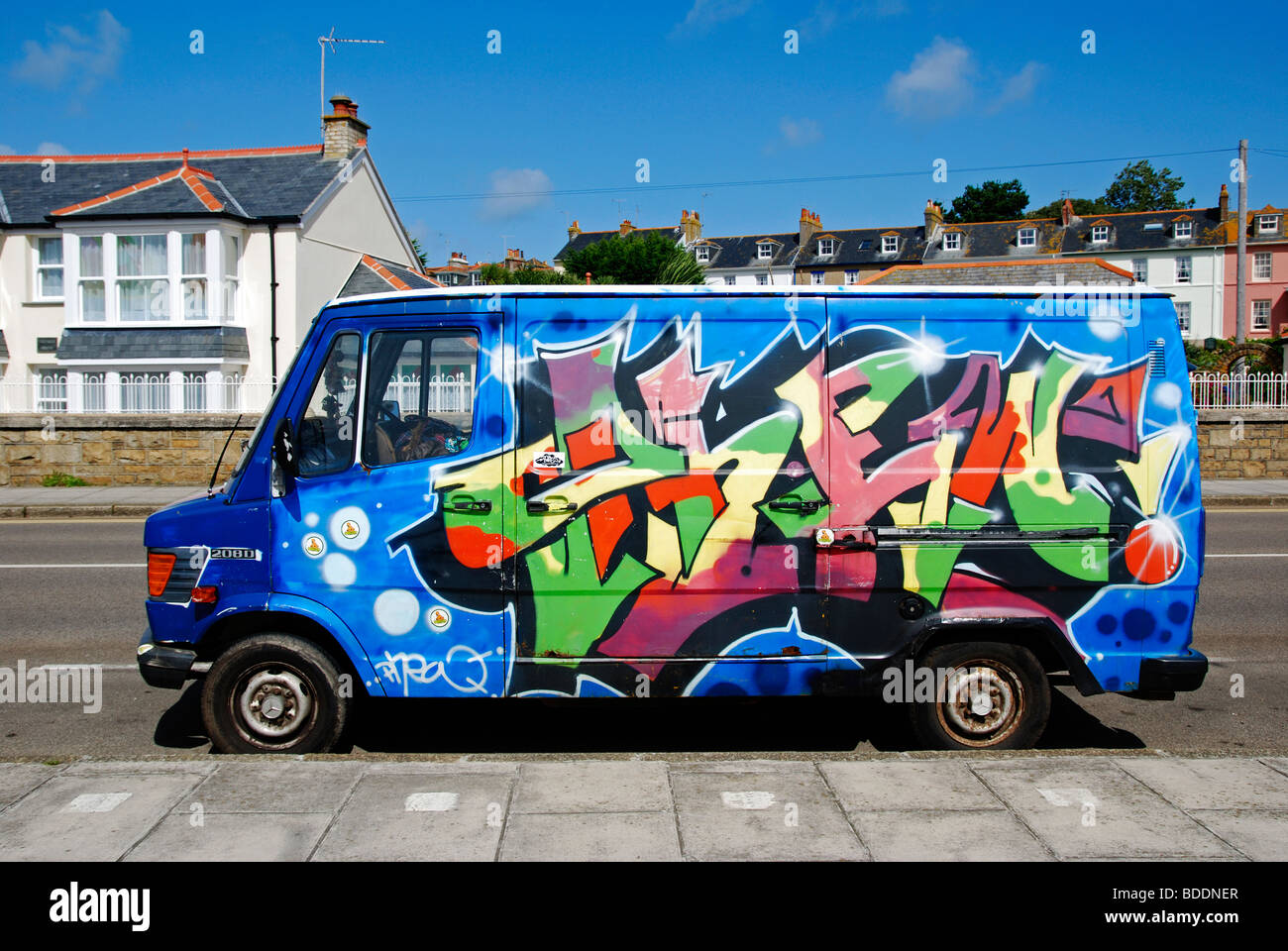 a ford transit van with graffiti style paintwork, uk - Stock Image