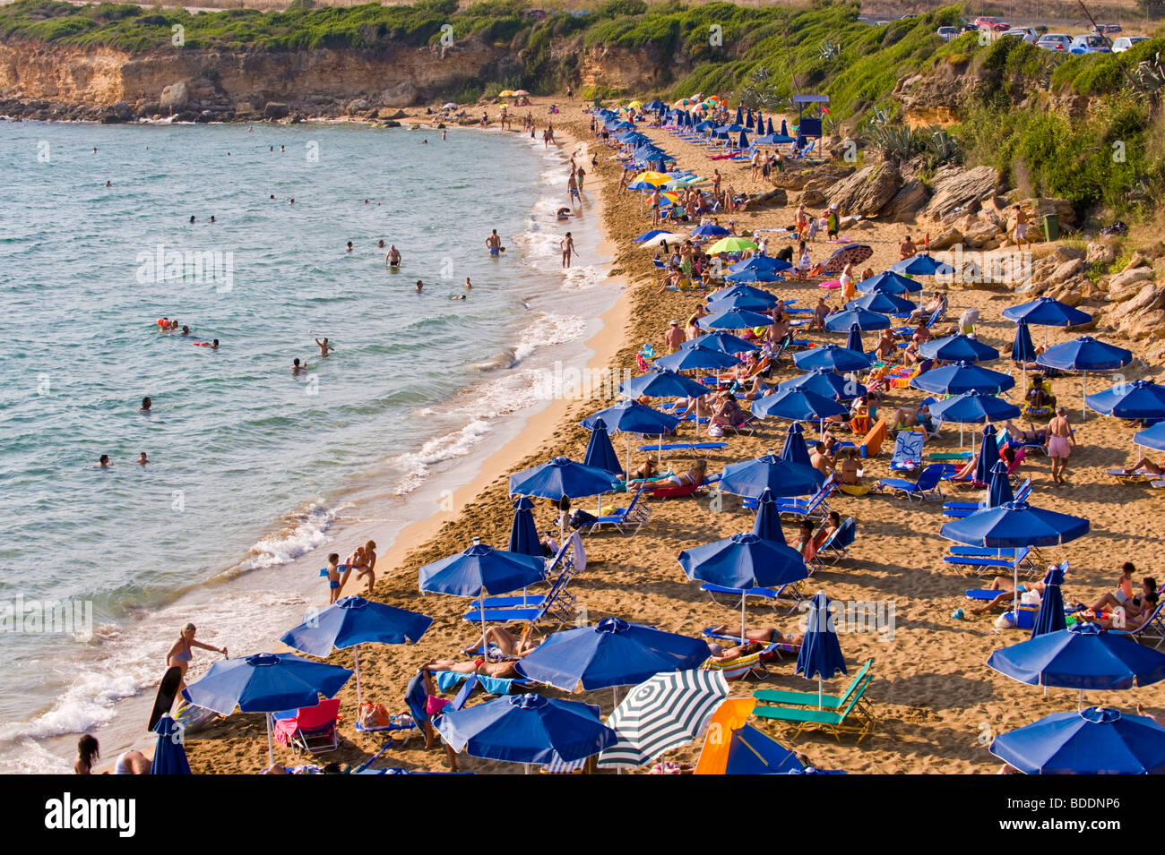 Holidaymakers sunbathing on a crowded Ammes Beach on the Greek Mediterranean island of Kefalonia Greece GR Stock Photo