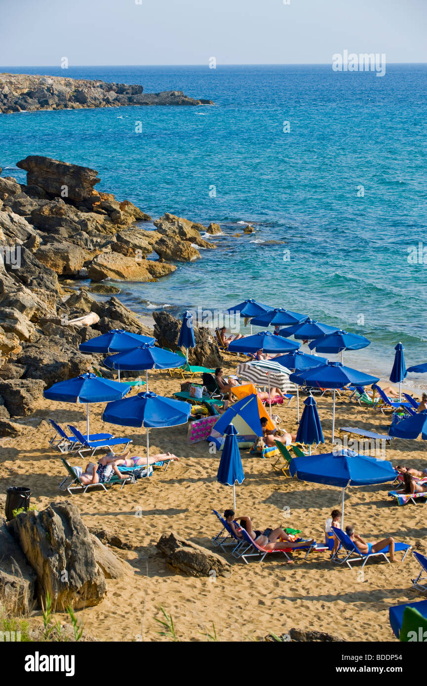 Holidaymakers sunbathing on a crowded Ammes Beach on the Greek Mediterranean island of Kefalonia Greece GR - Stock Image