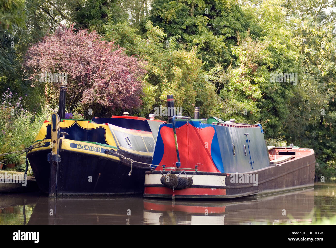 Moored traditional historic narrowboats at Cropredy on the South Oxford Canal © Doug Blane Stock Photo