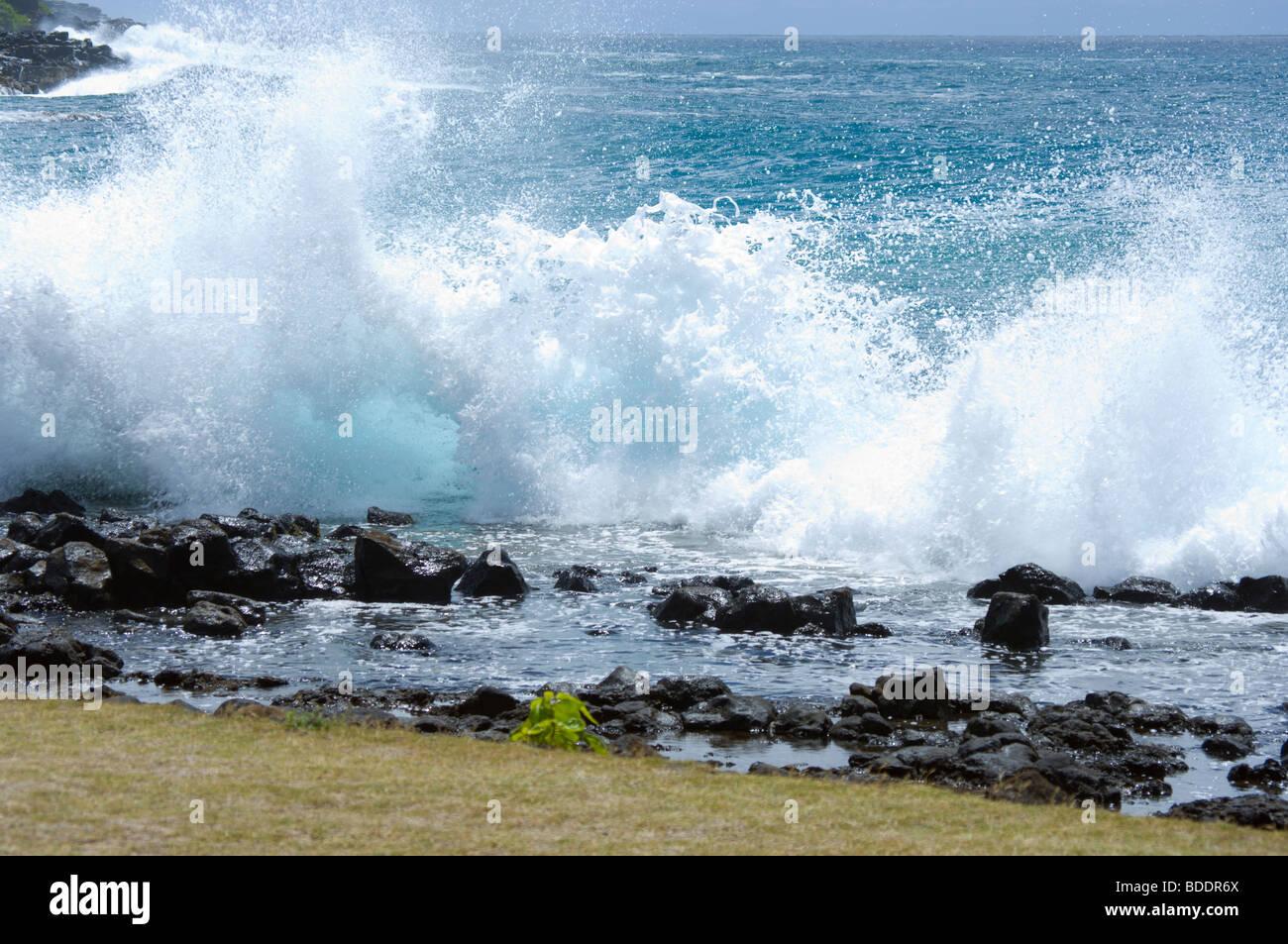 Breaking waves on Brennecke Beach Poipu Kauai HI - Stock Image