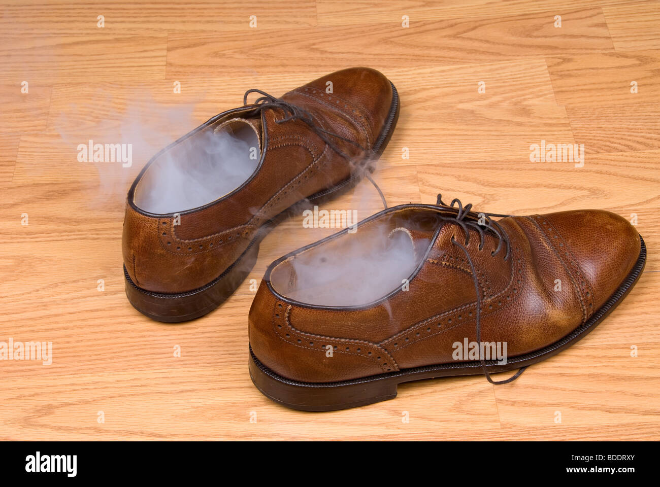 A pair of dress shoes steaming after a hot day of wear and tear. - Stock Image