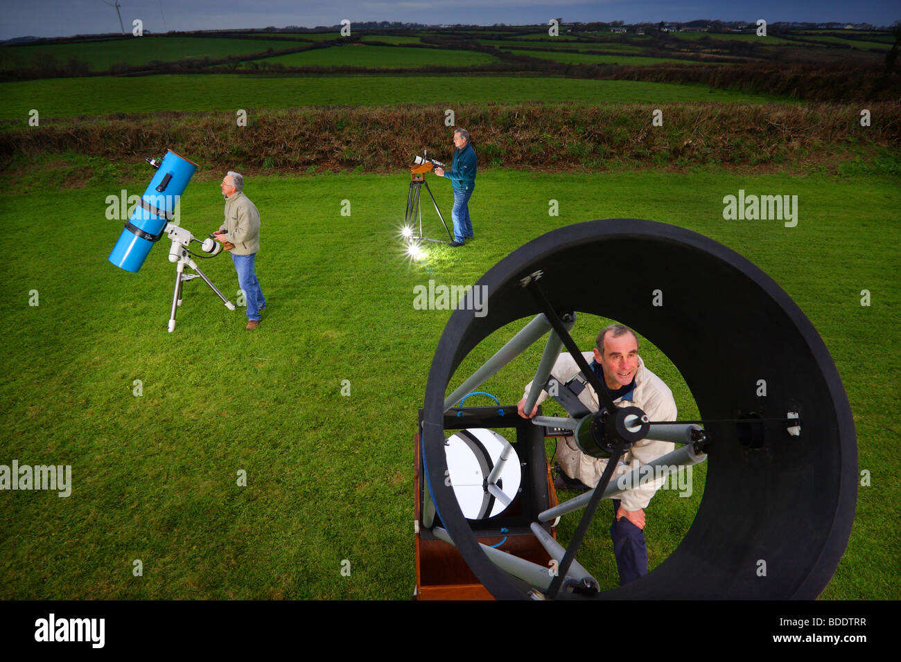 Night sky watchers prepare for darkness near Bradworthy in North Devon, England. - Stock Image