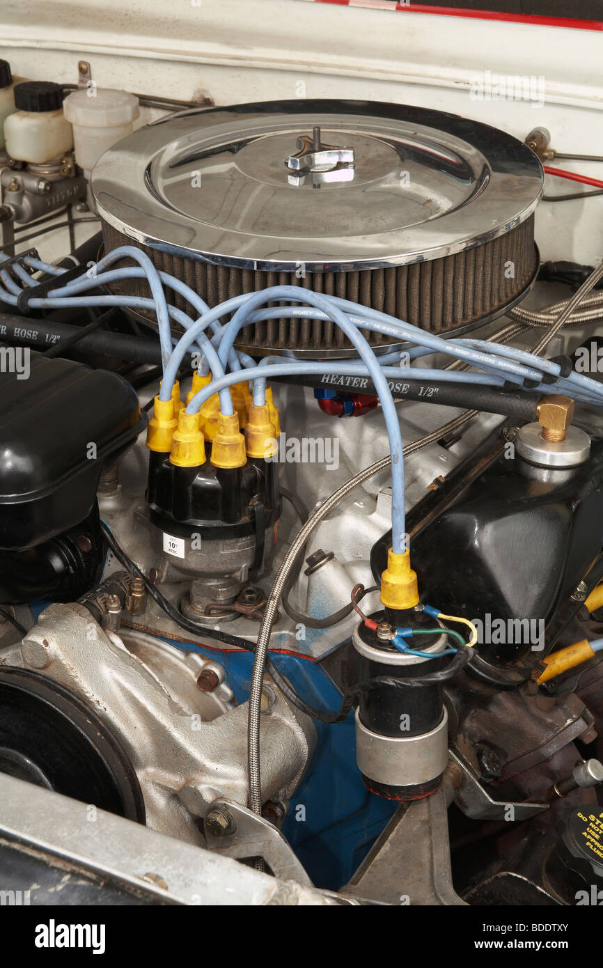 Ignition coil & distributor on a Classic race specification Ford V8 engine. - Stock Image