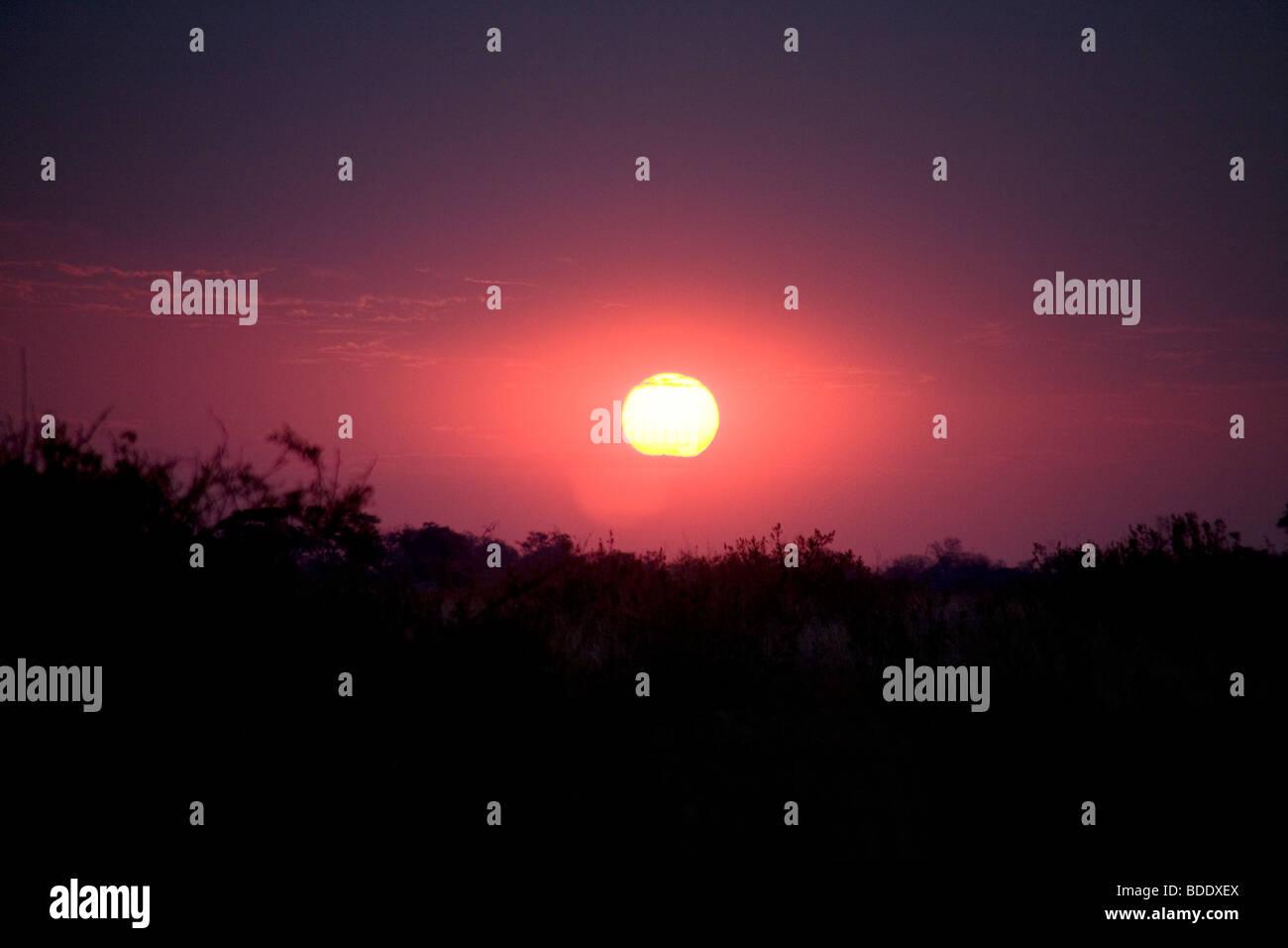 Botswana, Okavango Delta Selinda Camp Sunset - Stock Image