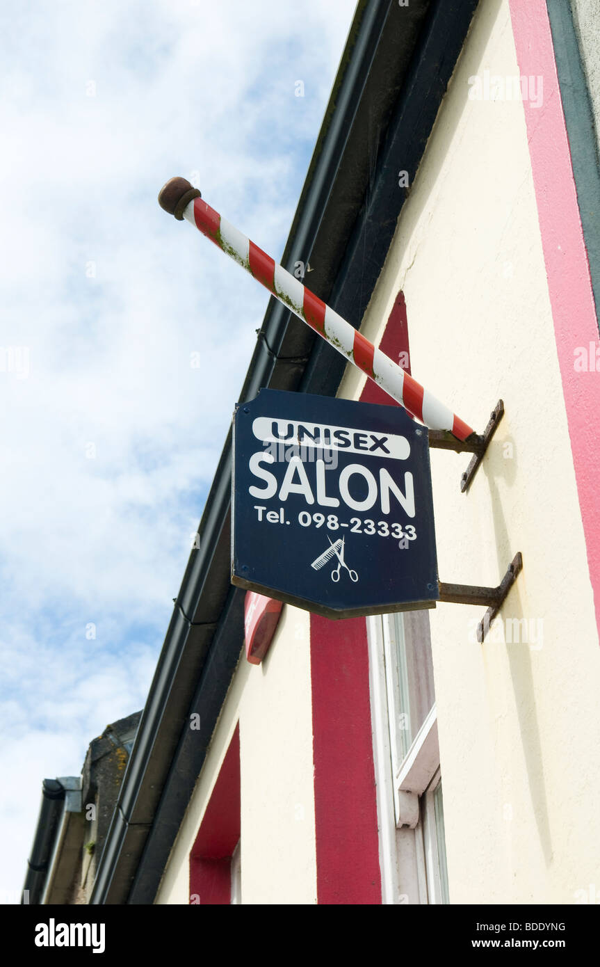An old-fashioned sign for a unisex hairdressing salon in the village of Louisburgh, County Mayo, Ireland - Stock Image