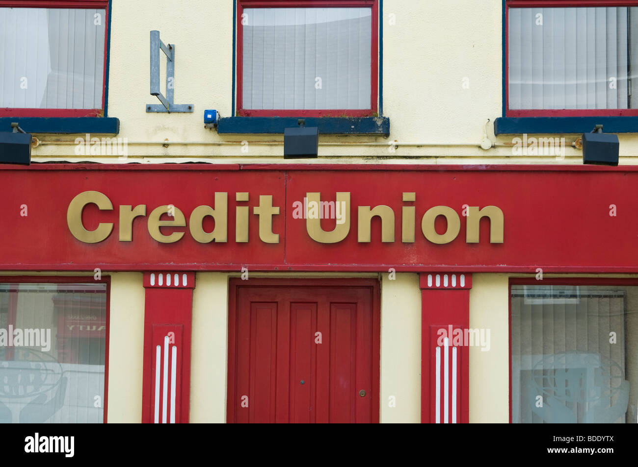 The colourful Credit Union offices in the village of Louisburgh, County Mayo, Ireland - Stock Image