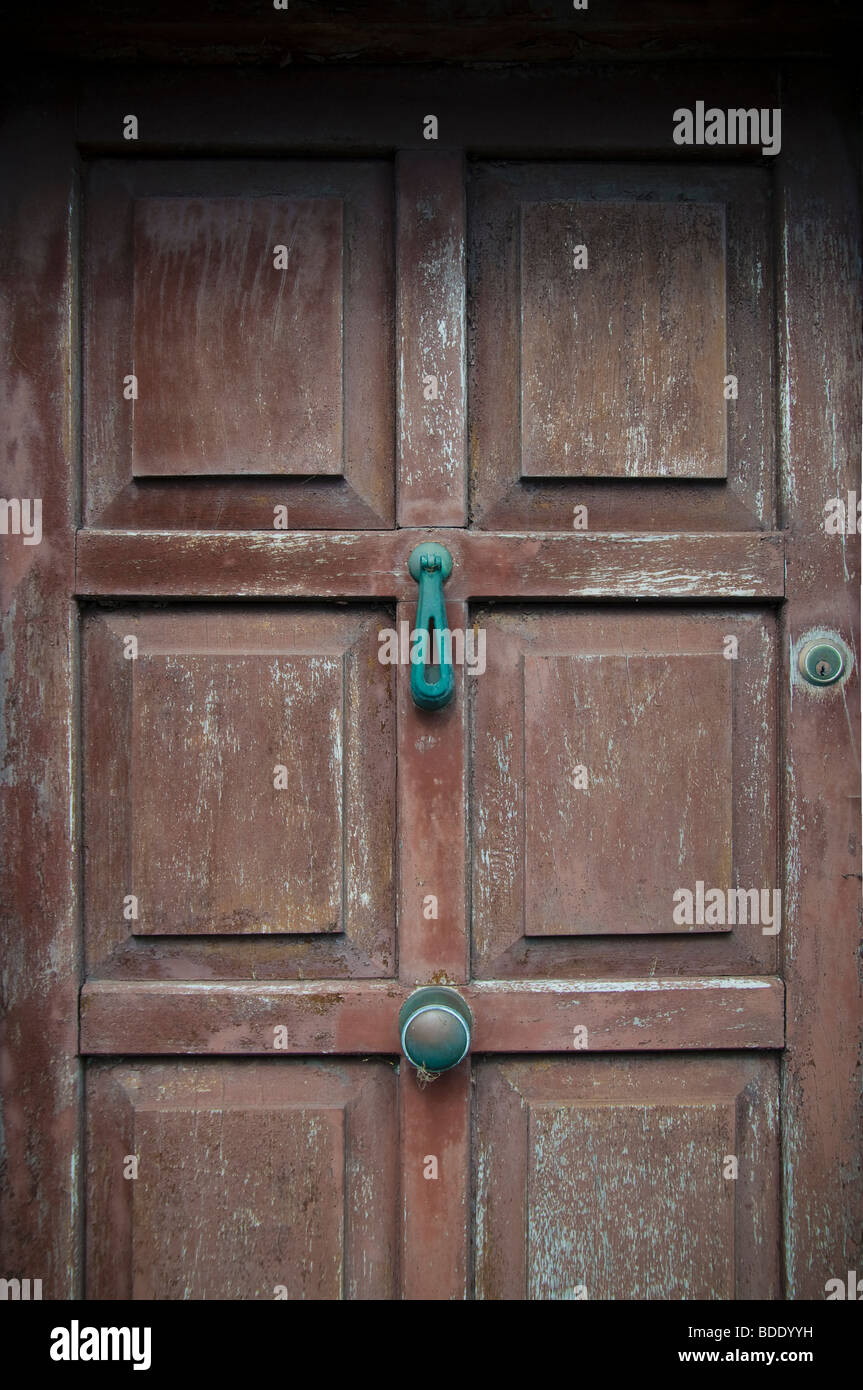 An old neglected brown house door in an Irish Village - Stock Image