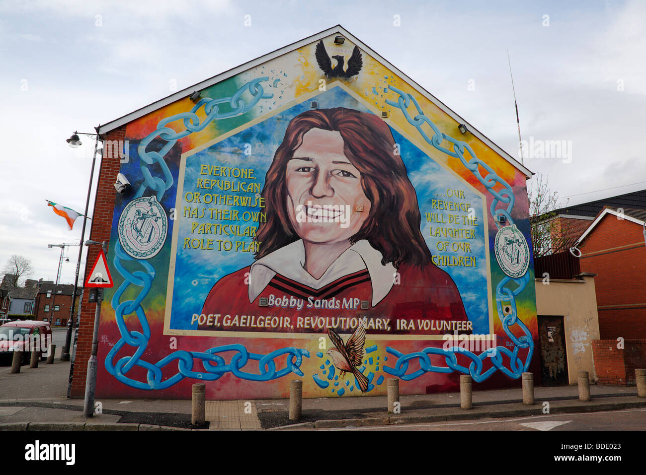 IRELAND, North, Belfast, West, Falls Road, Mural of Bobby Sands on the gable end of the Sinn Fein headquarters - Stock Image