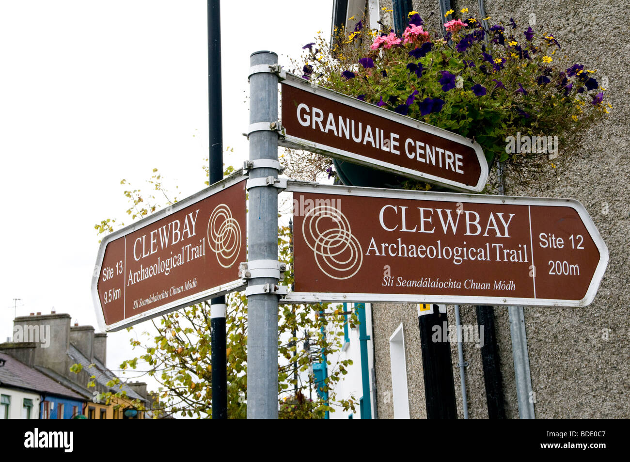 A signpost indicating the Clew Bay archaeological trail in the village of Louisburgh, County Mayo, Ireland - Stock Image