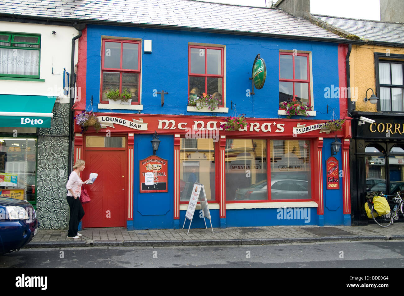 A colorfully decorated pub in the village of Louisburgh, county Mayo, Ireland - Stock Image