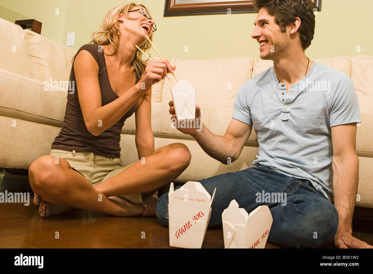 Beautiful young couple enjoying each others company - Stock Image