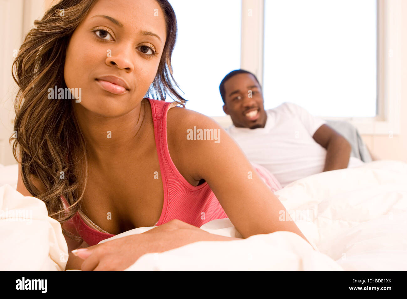 Couple in bed. - Stock Image