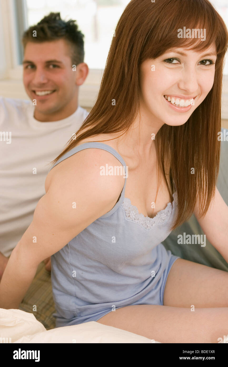 Happy couple in  bed. - Stock Image