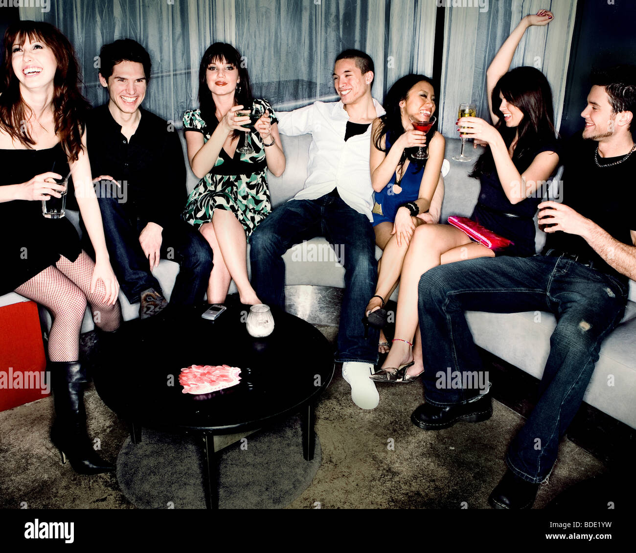 Friends at club, partying. - Stock Image