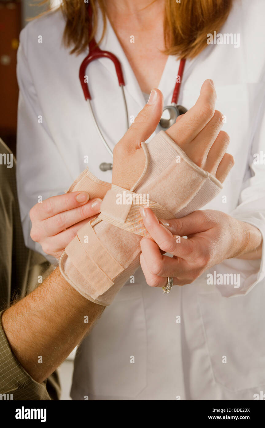 Treating a hand and wrist for carpal tunnel syndrome. - Stock Image