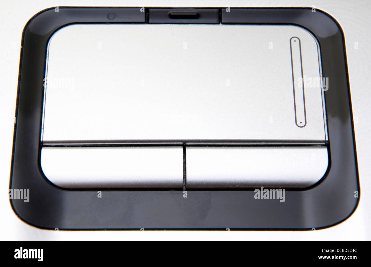 Silver laptop touchpad close up view - Stock Image