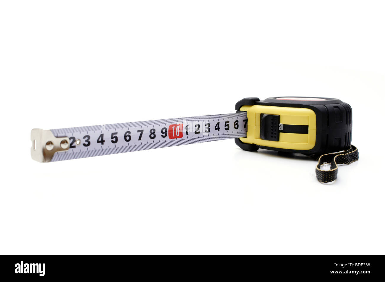 Opened tape measure on white isolated background - Stock Image