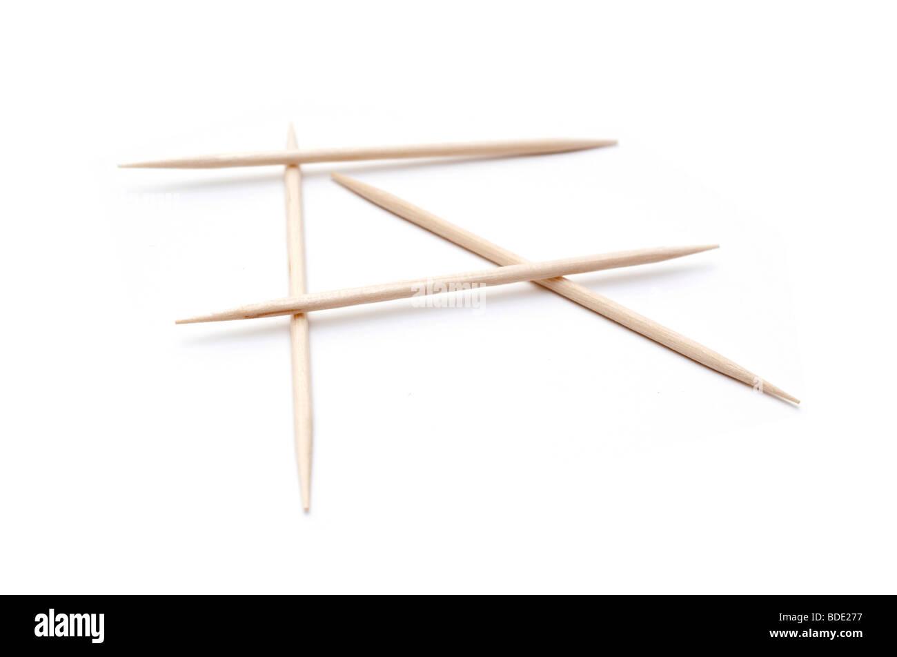 Few toothpicks on white background - Stock Image