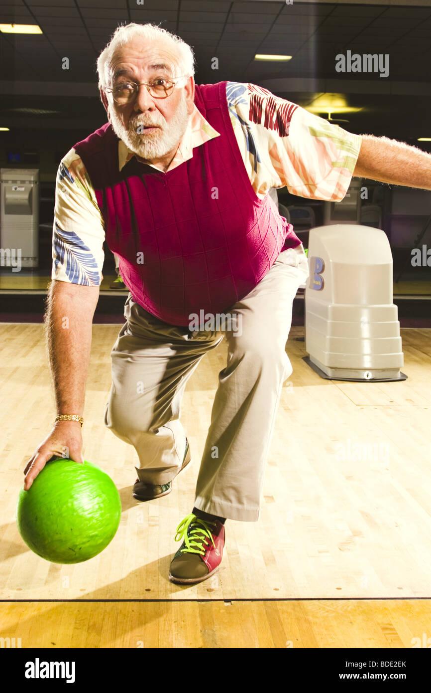 Portraits of a senior man bowling - Stock Image